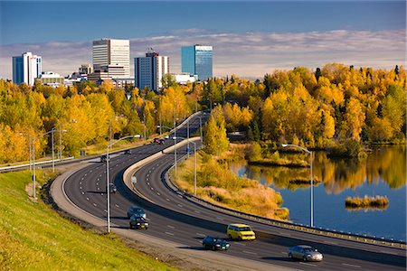 small town snow - Scenic view of Minnesota Blvd. traffic along Westchester Lagoon on a sunny day with downtown Anchorage in the distance, Southcentral Alaska, Fall Stock Photo - Rights-Managed, Code: 854-03646346