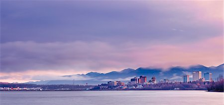 Skyline view of the sun rising over a fog shrouded Anchorage and Cook Inlet, Southcentral Alaska, Fall Stock Photo - Rights-Managed, Code: 854-03646364