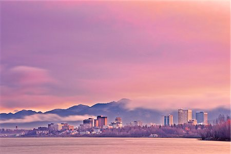 Skyline view of the sun rising over a fog shrouded Anchorage and Cook Inlet, Southcentral Alaska, Fall Stock Photo - Rights-Managed, Code: 854-03646361