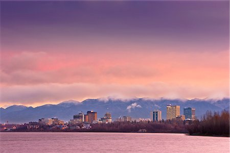 Skyline view of the sun rising over a fog shrouded Anchorage and Cook Inlet, Southcentral Alaska, Fall Stock Photo - Rights-Managed, Code: 854-03646362