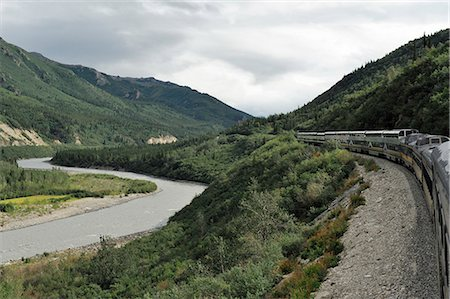 Scenic view of the Alaska Railroad Denali Star train along the Nenana River north of the Denali Depot on a late overcast afternoon, Interior Alaska, Summer Stock Photo - Rights-Managed, Code: 854-03646436