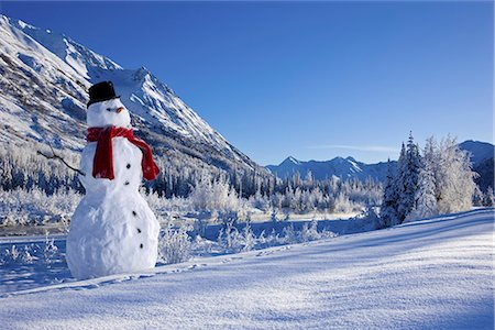 Snowman with a top hat and scarf in the Chugach Mountains,/nSouthcentral Alaska, Winter, COMPOSITE Stock Photo - Rights-Managed, Code: 854-03646481