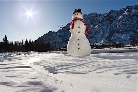 Snowman with a red scarf and black top hat sitting on the frozen Nenana River with the Alaska Range foothills in the background, Southcentral Alaska, Winter Stock Photo - Rights-Managed, Code: 854-03646514