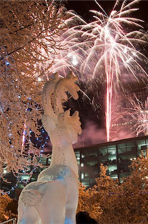 Hoar frost covered caribou ice sculpure in Town Square Park with fireworks overhead during the 50th Anniversary Statehood celebration in Downtown Anchorage, Southcentral Alaska, Winter Stock Photo - Rights-Managed, Code: 854-03646601