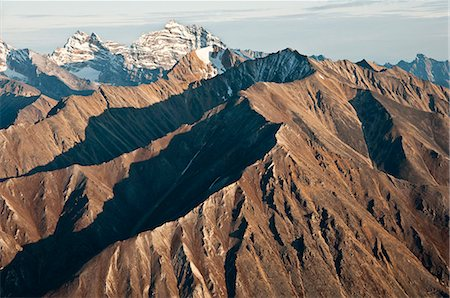Aerial view of Mt.Igikpak (right) of the Schwatka Mountains and Brooks Range, the highest peak in Gates of the Arctic National Park & Preserve, Arctic Alaska, Fall Stock Photo - Rights-Managed, Code: 854-03646688