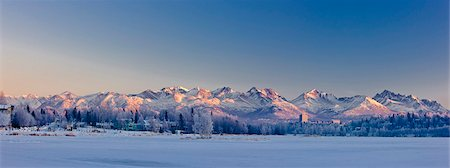 panoramic winter scene - Panoramic view of the sunset casting a pink glow over the Chugach Mountains, Anchorage, Southcentral Alaska, Winter Stock Photo - Rights-Managed, Code: 854-03646707