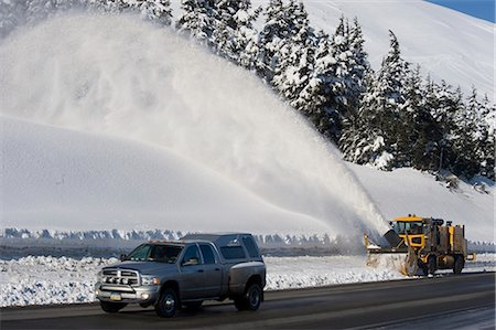 snow plow truck - A snowblower follows a truck up the highway in Turnagain Pass, Kenai Peninsula, Southcentral Alaska, Winter Stock Photo - Rights-Managed, Code: 854-03646799