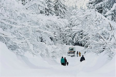 Stranded Girdwood residents look for help from a snowplow driver after a deep snowstorm, Southcentral Alaska, Winter Stock Photo - Rights-Managed, Code: 854-03646800