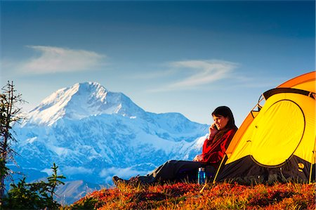 south - Woman talking on her cell phone while camping with the south summit of Mt. McKinley in the background, Peters Hills, Denali State Park, Southcentral Alaska, Fall/n Stock Photo - Rights-Managed, Code: 854-03646849