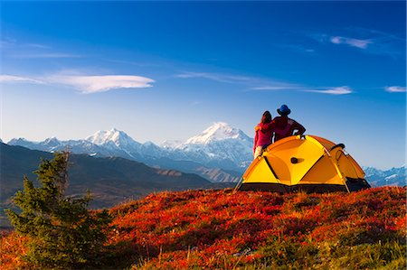A couple view Mt.McKinley from their campsite in Peters Hills, Denali State Park, Southcentral Alaska, Fall/n Stock Photo - Rights-Managed, Code: 854-03646870