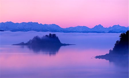 Foggy and pink sunset over the Chilkat Mountains and Favorite Passage near Juneau, Inside Passage, Southeast Alaska, Winter Stock Photo - Rights-Managed, Code: 854-03662580