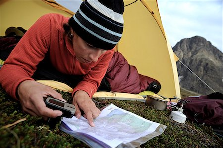 Woman in a tent consults a GPS and map while camping at Rabbit Lake, Chugach State Park, Southcentral Alaska, Autumn Stock Photo - Rights-Managed, Code: 854-03739547