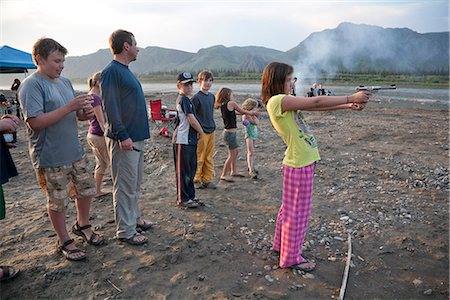preteen thong - A 12 year old girl stands and shoots a .22 pistol in her pajamas and flip-flops at the edge of the Yukon River during a raft float trip, Yukon-Charley Rivers National Preserve  Interior Alaska, Summer Stock Photo - Rights-Managed, Code: 854-03739746