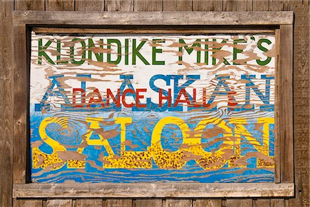 saloon - Close up of a sign for Klondike Mike's Alaskan Saloon, Palmer, Southcentral Alaska, Summer. Digitally altered Stock Photo - Rights-Managed, Code: 854-03739898