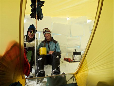 Two climbers in their tent at Camp Three on the West Buttress Route, Kahiltna Glacier on Mt. McKinley, Denali National Park and Preserve, Interior Alaska, Summer Stock Photo - Rights-Managed, Code: 854-03740033