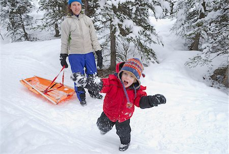 family fun day background - Preschool age boy throwing a snow ball while his mother watches on, Chugach State Park, Southcentral Alaska, Winter Stock Photo - Rights-Managed, Code: 854-03740268