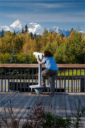 scope - Woman visitor looks through telescope at the southside view of Mt. Mckinley and Alaska Range from the Alaska Veterans Memorial rest area along George Parks Highway, Denali State Park, Southcentral Alaska, Autumn Stock Photo - Rights-Managed, Code: 854-03844969