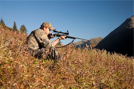 scope - Male moose hunter sits on a hillside and aims with a rifle, Bird Creek drainage area, Chugach Mountains, Chugach National Forest, Southcentral Alaska, Autumn Stock Photo - Rights-Managed, Code: 854-03845079
