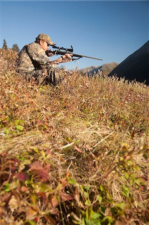scope - Male moose hunter sits on a hillside and aims with a rifle, Bird Creek drainage area, Chugach Mountains, Chugach National Forest, Southcentral Alaska, Autumn Stock Photo - Rights-Managed, Code: 854-03845080