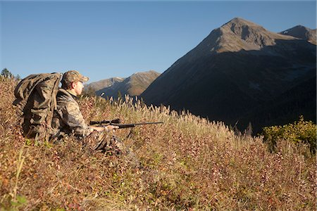 scope - Male moose hunter sits on a hillside and aims with a rifle, Bird Creek drainage area, Chugach Mountains, Chugach National Forest, Southcentral Alaska, Autumn Stock Photo - Rights-Managed, Code: 854-03845081