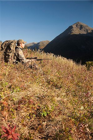 scope - Male moose hunter sits on a hillside and aims with a rifle, Bird Creek drainage area, Chugach Mountains, Chugach National Forest, Southcentral Alaska, Autumn Stock Photo - Rights-Managed, Code: 854-03845082