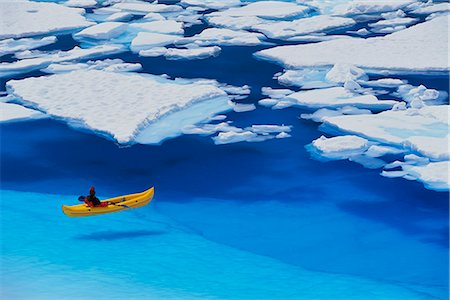 quest - Female kayaker navigates through a melt pond in the Juneau /nIcefield, Coast Mountains, Tongass National Forest, Southeast Alaska, Summer Stock Photo - Rights-Managed, Code: 854-03845109
