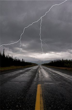 storm lightning - Lightning strike and storm over the Alcan Highway, Yukon Territory, Canada, Summer Stock Photo - Rights-Managed, Code: 854-03845434