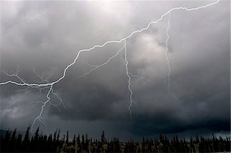 Lightning strike and storm over the Alcan Highway, Yukon Territory, Canada, Summer Stock Photo - Rights-Managed, Code: 854-03845435