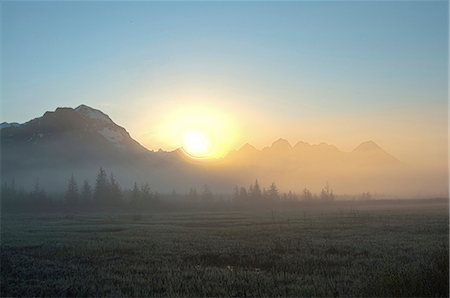 roads and sun - Morning fog hangs on the ground near the Copper River Highway as the sun rise over the Chugach Mountains, Chugach National Forest, Southcentral Alaska, Spring. HDR Stock Photo - Rights-Managed, Code: 854-03846115