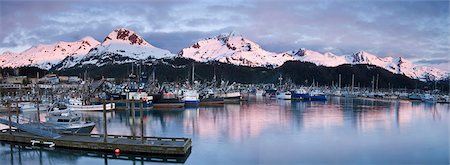 small town snow - Evening alpenglow on the Chugach Mountains and Mt. Eyak behind the boat harbor at Cordova, Southcentral Alaska, Spring Stock Photo - Rights-Managed, Code: 854-03846119