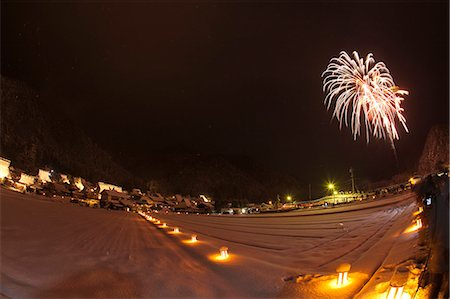 Fireworks celebrating the snow lantern festival with traditional folk houses covered with snow, Miyama-cho, Kyoto Prefecture, Japan Stock Photo - Rights-Managed, Code: 855-06022581