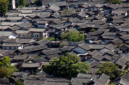 Residential rooftops at the ancient city of Lijiang, Yunnan Province, China Stock Photo - Rights-Managed, Code: 855-06313039