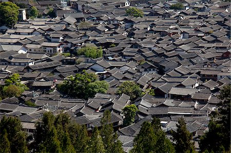 Residential rooftops at the ancient city of Lijiang, Yunnan Province, China Stock Photo - Rights-Managed, Code: 855-06313041