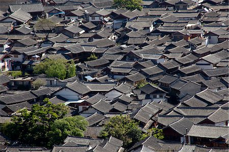 Residential rooftops at the ancient city of Lijiang, Yunnan Province, China Stock Photo - Rights-Managed, Code: 855-06313042