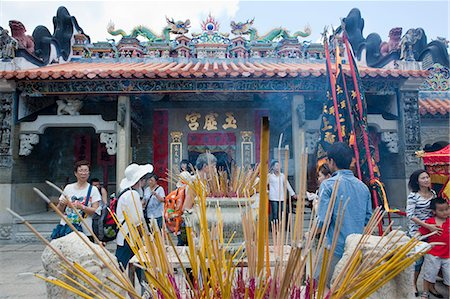 Worshipper offering incense at Pak Tai Temple during the Bun festival, Cheung Chau, Hong Kong Stock Photo - Rights-Managed, Code: 855-06313354