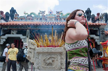 Foreign visitors sharing the atmosphere of the Bun festival at Pak Tai Temple, Cheung Chau, Hong Kong Stock Photo - Rights-Managed, Code: 855-06313358