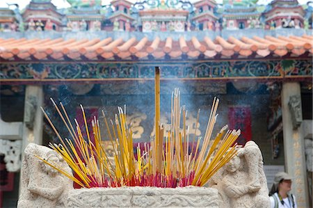 Offering of incense at Pak Tai Temple during the Bun festival, Cheung Chau, Hong Kong Stock Photo - Rights-Managed, Code: 855-06313359