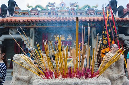 Worshipper offering incense at Pak Tai Temple during the Bun festival, Cheung Chau, Hong Kong Stock Photo - Rights-Managed, Code: 855-06313353