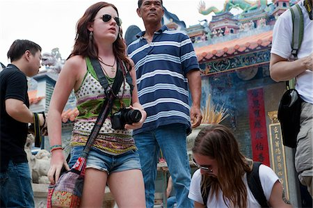Foreign visitors sharing the atmosphere of the Bun festival at Pak Tai Temple, Cheung Chau, Hong Kong Stock Photo - Rights-Managed, Code: 855-06313360