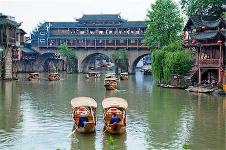Tuo River and the roof covered bridge at Phoenix old town, Zhangjiazie, Hunan, China Stock Photo - Rights-Managed, Code: 855-06338791