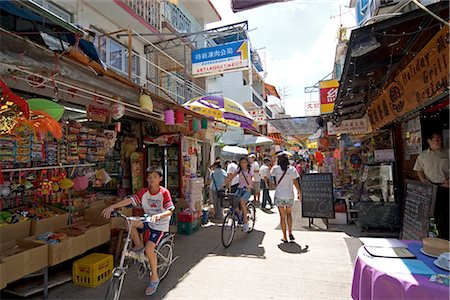 Leisure on Yung Shu Wan Main Street,Lamma Island,Hong Kong Stock Photo - Rights-Managed, Code: 855-03024113
