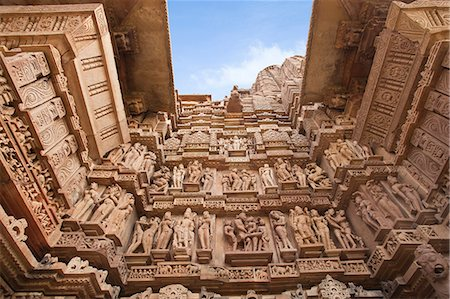 erotic female figures - Low angle view of erotic carvings at a temple, Khajuraho, Chhatarpur District, Madhya Pradesh, India Stock Photo - Rights-Managed, Code: 857-06721521