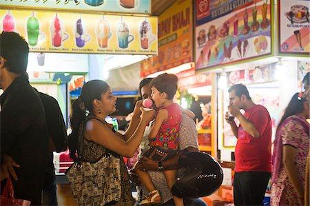 families eating ice cream - People at an ice cream parlor, Juhu Beach, Mumbai, Maharashtra, India Stock Photo - Rights-Managed, Code: 857-06721667