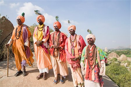 Five sadhus standing on a rock, Hampi, Karnataka, India Stock Photo - Rights-Managed, Code: 857-03192795