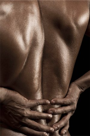 Rear view of a man flexing muscles Stock Photo - Rights-Managed, Code: 857-03554061