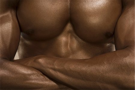 Mid section view of a man flexing muscles Stock Photo - Rights-Managed, Code: 857-03554062
