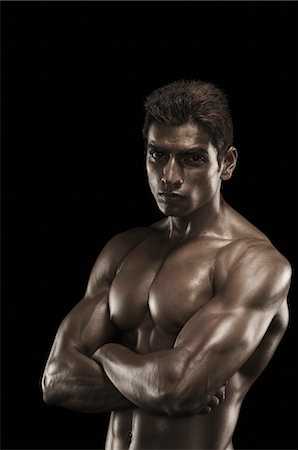 Portrait of a man flexing muscles Stock Photo - Rights-Managed, Code: 857-03554063