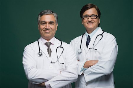 dependable - Portrait of two doctors smiling Stock Photo - Rights-Managed, Code: 857-03554171