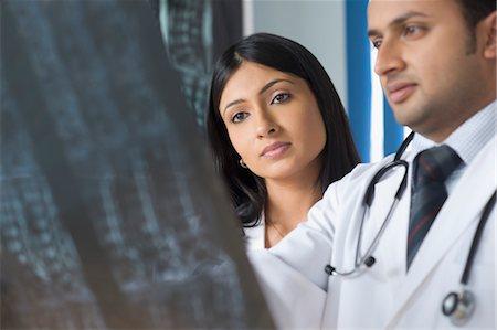 female surgeons india - Two doctors examining an x-ray report, Gurgaon, Haryana