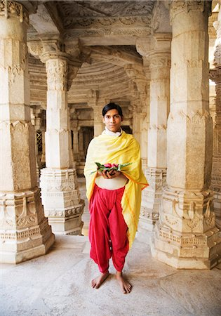 Teenage boy holding religious offering in a temple, Adinath Temple, Jain Temple, Ranakpur, Pali District, Udaipur, Rajasthan, India Stock Photo - Rights-Managed, Code: 857-03553549